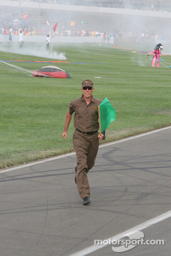 The UPS man is carrying the green flag
