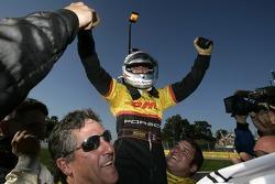 Race winner Romain Dumas celebrates