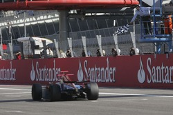 Timo Glock crosses the line take victory