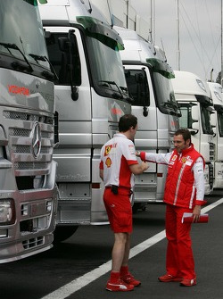 Stefano Domenicali, Scuderia Ferrari, Sporting Director outside McLaren Mercedes holding a document