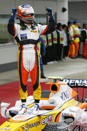 Heikki Kovalainen celebrates second place finish