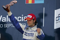 Andy Soucek celebrates on the podium