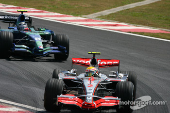 Lewis Hamilton, McLaren Mercedes, MP4-22 leads Rubens Barrichello, Honda Racing F1 Team, RA107