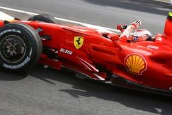 Race winner and 2007 World Champion Kimi Raikkonen celebrates