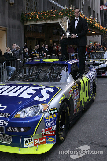 Jimmie Johnson climbs atop his No. 48 Lowe's Chevrolet on Park Avenue outside the Waldorf=Astoria