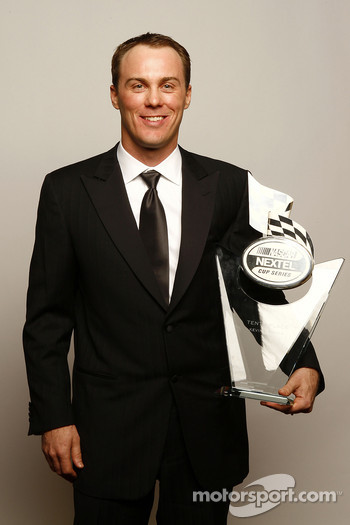 Kevin Harvick holds the trophy for the 10th place driver in the NASCAR NEXTEL Cup Series standings