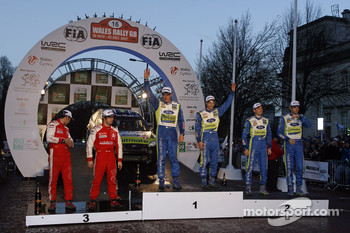 Podium winners Mikko Hirvonen and Jarmo Lehtinen, second place Marcus Gronholm and Timo Rautiainen, third place Sbastien Loeb and Daniel Elena