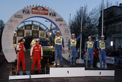 Podium winners Mikko Hirvonen and Jarmo Lehtinen, second place Marcus Gronholm and Timo Rautiainen, third place Sébastien Loeb and Daniel Elena