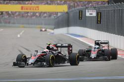 Jenson Button, McLaren MP4-30 leads team mate Fernando Alonso, McLaren MP4-30