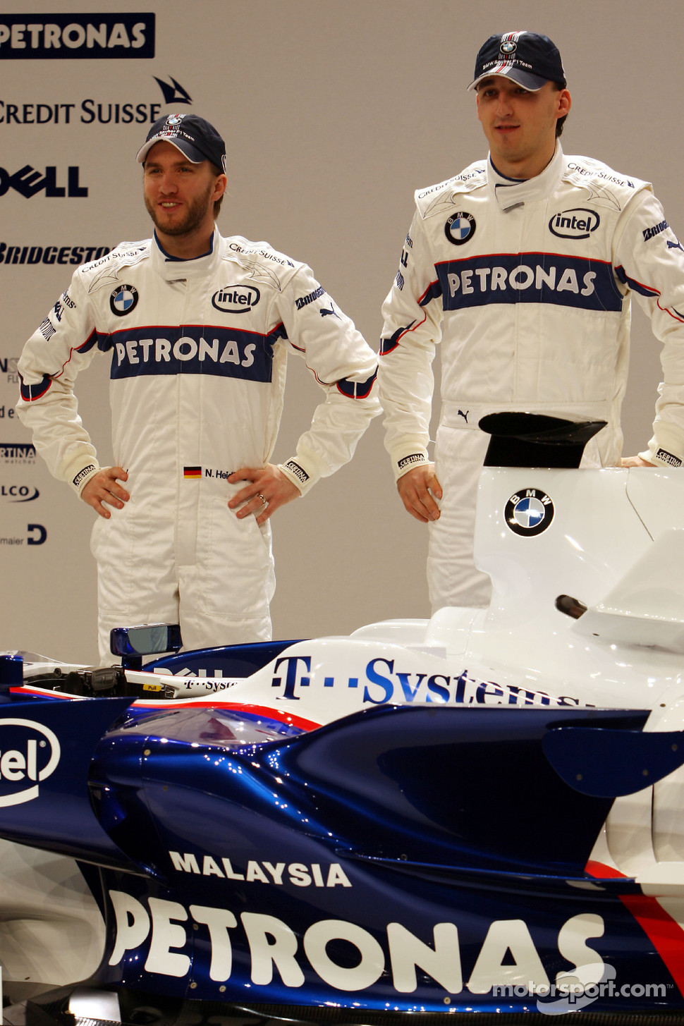 Robert Kubica and Nick Heidfeld pose with the new BMW Sauber F1.08