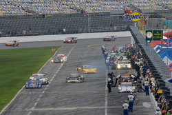 DP cars come down pit road during a full course yellow