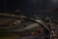 Race action at night on NASCAR turn 1