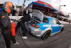 Pit stop for #13 Pipelayer Racing Mazda RX-8: Ricky Diaz, Manuel Vicente
