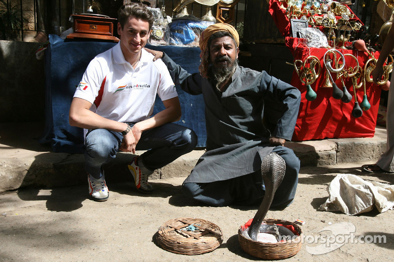 Adrian Sutil and a snake charmer with a King Cobra