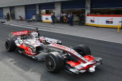 Heikki Kovalainen, McLaren Mercedes, MP4-23, drives past the Renault F1 Team, garage