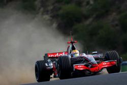 Lewis Hamilton, McLaren Mercedes, MP4-23, kicks up some dirt