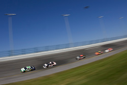 Scott Wimmer leads a pack into turn 4
