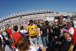 Fans watch the garage activity as the cars come and go on track