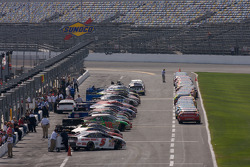 Sprint Cup cars wait on pit road while Nationwide cars are already aligned for qualifying