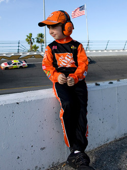 A young Tony Stewart fan enjoys watching the race cars go by