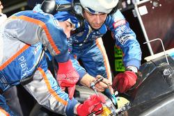 Pescarolo Sport team members at work while Emmanuel Collard sits in the car