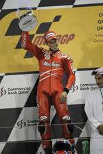 Podium: race winner Casey Stoner celebrates