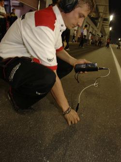 Bridgestone technician takes track temperature