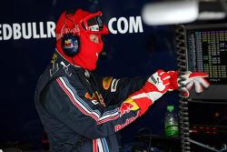 A Red Bull Racing crew member in the garage