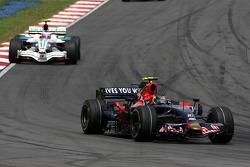 Sebastian Vettel, Scuderia Toro Rosso leads Rubens Barrichello, Honda Racing F1 Team