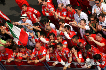 Scuderia Ferrari wait for Kimi Raikkonen, Scuderia Ferrari to come onto the podium
