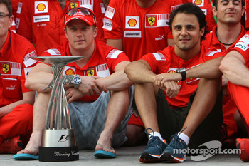 Team celebration: race winner Kimi Raikkonen celebrates with Felipe Massa and Scuderia Ferrari team members