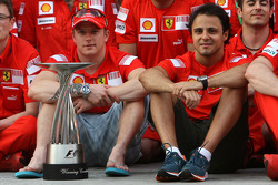 Team celebration: race winner Kimi Raikkonen celebrates with Felipe Massa and Scuderia Ferrari team members