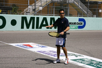 Helio Castroneves plays tennis with pro David Nabaldian on the Homestead front straight