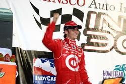 Podium: race winner Scott Dixon celebrates