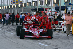 Dan Wheldon's car is wheeled onto the grid