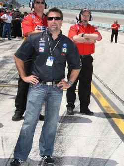 Michael Andretti looks on