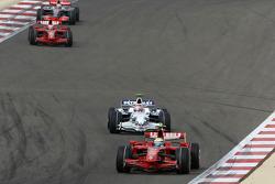Felipe Massa, Scuderia Ferrari, F2008 and Robert Kubica, BMW Sauber F1 Team, F1.08