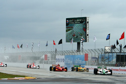 Tony Kanaan leads the field into Turn One
