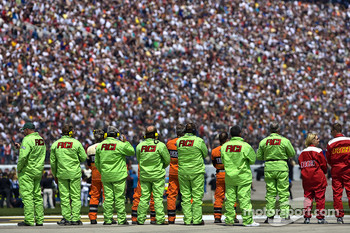 The Safety Crew stands for the National Anthem