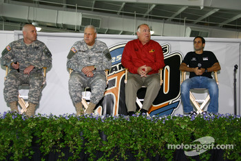 A member of the U.S. Army National Guard, Indiana National Guard General Martin Umbarger, Panther Racing co-owner John Barnes, Panther Racing driver Vitor Meira