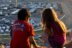 Race fans enjoy the beautiful sunset while watching the race