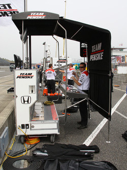 Team Penske crew members prepare their pit box