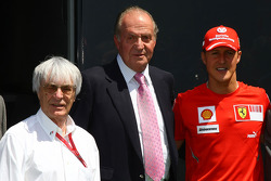 Bernie Ecclestone, President and CEO of Formula One Management with Juan Carlos I, King of Spain and Michael Schumacher, Test Driver, Scuderia Ferrari