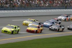 Paul Menard leads a group of cars