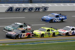 Brian Vickers leads a group of cars