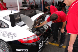 Technicians attend to the Farnbacher Loles Porsche GT3 Cup