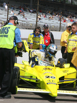 Ed Carpenter exits the car after pulling the car out of the qualifying line