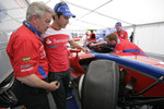 Bruno Senna and Paul Jackson, iSport International Team Principal look at his damaged car