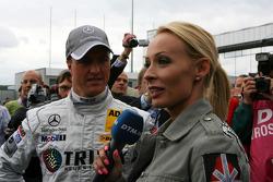 Cora Schumacher, wife of Ralf Schumacher, interviewing her husband Ralf Schumacher, Mücke Motorsport AMG Mercedes, for DTM TV