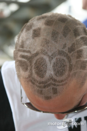 A racing fan has the 500 cut into his hair